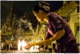 Lighting candles at the Shwedagon Pagoda