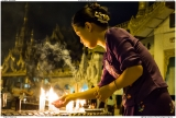 Lighting candles at the Shwedagon Pagoda